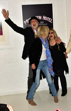 a fun photo of Christine McVie, Mick Fleetwood and Stevie ~ ☆♥❤♥☆ ~ at the opening of her '24 Karat Gold:Songs From The Vault' photo gallery, held at the Morrison Hotel ~ reliving their younger days