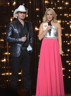 Pin for Later: You Have to See All 11 of Carrie Underwood's Striking CMA Awards Dresses Carrie Underwood's CMA Awards Style Carrie's pink Theia dress was one of her more eye-catching numbers, featuring sparkly straps and a floral-printed silk bodice.
