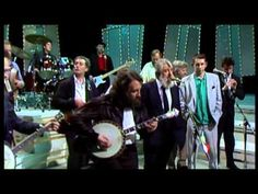 The Dubliners & The Pogues - The Irish Rover (The Late Late Show) - YouTube <3 Ronnie Drew! (Dubliners' lead singer).  Shane MacGowan just doesn't care...smoking and drinking during a performance!  LOL!