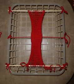 From Franco's Fiber Adventure: A Fast Sprang Frame with a cheap plastic basket, some sticks and string.