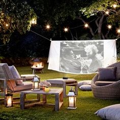 Take Movie Night Outdoors: string a sheet up between 2 trees & use a projector. Add popcorn, blankets and cushions.