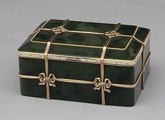 Box in the form of a banded trunk House of Carl Fabergé Date: 1899–1908 Culture: Russian (Moscow) Medium: Nephrite, gold, ename, diamonds.