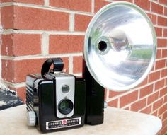 Kodak BROWNIE HAWKEYE Camera w/ Flash Unit. Had this camera while in elementary school. My father's hand me down. Used it to teach me photography. But - it was really only point and click and roll the film for the next shot. You looked down into the view finder from the backside top.