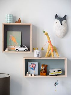 Simple shelves with colored background. Maybe DIY it with some colored paper for a splash of color?