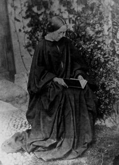 Photographer Julia Margaret Cameron reading a book, 1860