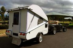 This little teardrop by Wombat Conversions may look pretty inconspicuous, but it& capable of undergoing a total metamorphosis. Small Camper Trailers, Teardrop Camper Trailer, Slide In Camper, Small Trailer, Small Campers, Travel Trailers, Micro Campers, Camp Trailers, Airstream Trailers