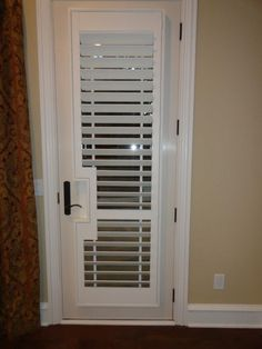 Shutter on a door Shutters, Home Appliances, Doors, Laundry Room, Sunroom Blinds, House Appliances, Shades, Appliances, Blinds
