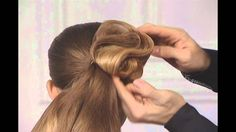 Gorgeous retro wave swirly updo. This man is a hair magician!