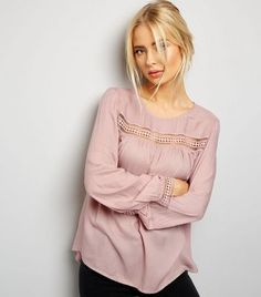 """Introduce shell pink hues to your everyday wardrobe this season with this cut out trim top. Pair with jeans and heeled boots to complement.- Rounded neckline- Cut out trim- Simple long sleeves- Button back fastening- Casual fit that is true to size- Margaux is 5'8.5""""/174cm and wears UK 10/EU 38/US 6"""