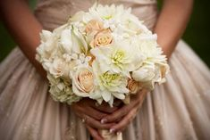 Traditional wedding bouquet stephanotis brides flowers bouquet in ivory and champagne. Flora Nova Design