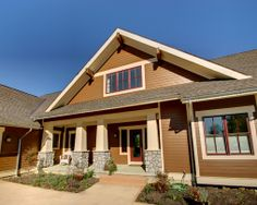 This understated front entry is typical of  Craftsman-styled homes like this one with great details and a custom window color.  Learn more here: http://www.rtastudio.com/Portfolio/Custom%20Homes/Craftsman%20Cottage/Craftsman-Bungalow-Custom-Home-Marysville-Ohio-Residential-Architect.html