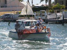 Mandurah Mayor will award the Best Dressed boat in the Mandurah Australia Day flotilla – seen here floating past our jetty at Port Sails Canal Villa