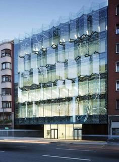 Historical Archive of the Basque Country by ACXT, Bilbao, Spain - The main façade has been designed as a vibrating glass front. The outer glass skin is printed with extracts of texts from some of the documents preserved within the archive, in such a way that the building is not seen as sealed place, private and closed off from the citizen.