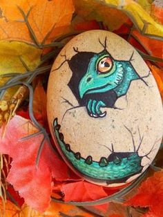 Image result for rock painting egg with dinosaur eye