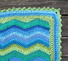 To edge my Ripple, I straightened the ripply edges by making long and short stitches, then went around and around a few times in dc before adding my favourite, a picot edge.