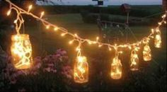 cicle lights are big in outdoor weddings, and allow for several unique ideas in DIY wedding lighting. Using mason jars with wire handles, icicle light drops can be tucked into the glasses, resembling fireflies from a distance, and creating romantic evening lighting. Since mason jars are inexpensive, this is a great trick in wedding lighting that creates a beautiful decoration while keeping costs minimal.