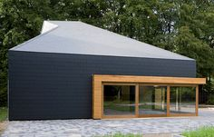 Good example of modern hanging slates as wall cladding. Marley Eternit Thrutone fibre cement slates