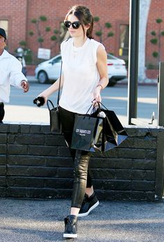 Kendall Jenner in leather pants + high top sneakers + cat-eye sunglasses