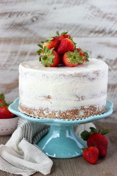 This fresh homemade Strawberry Cake is covered with a lemon Swiss Meringue Buttercream. The cake is incredibly moist and bursting with fresh strawberry flavor.