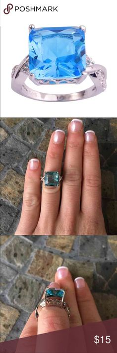 Aqua Princess Gem Silver CrissCross Ring Very pretty stone!  Large Aqua blue center gemstone  Criss Cross silver band with white stones  925 stamped silver FIRM PRICE/NO TRADES❗️ Jewelry Rings