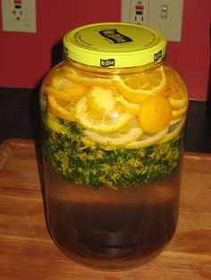 Dandelion Wine: 2 packages baker's yeast, 2.5 cups sugar, 1 quart dandelions, 1 thinly sliced lemon, 1 thinly sliced orange, fill with tap water. Vent the lid and place in the dark for 3 weeks. Strain using cheesecloth and return liquid to jar. Wait another 3 weeks and strain again. It may last on the shelf, if well-sealed, for several years.