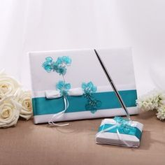 Teal Blue Wedding Guest Book And Pen Set With Acrylic Flowers   from  JJ's House, Bridal & bridal accessories.  www.jjshouse.com We ship to Australia, Canada, U.K. New Zealand, Switzerland, Norway, Russia, Brazil, Netherlands & the USA.   Please mention that you found them thru Jevel Wedding Planning's Pinterest Account.  Keywords: #guestbooks #tealbluethemedweddingguestbooks #jevelweddingplanning Follow Us: www.jevelweddingplanning.com  www.facebook.com/jevelweddingplanning/