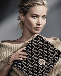 Jennifer Lawrence in this seasons Dior campaign. The 'Diorama' bag is revisited satchel-style and available in a Dior print fabric embroidered with black tufted velvet.