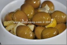 Home Pickled Green Olives Recipe Mediterranean style. You will love the lemony-tangy flavor of these pickled olives. For recipe http://www.dish-away.com/2012/11/pickled-green-olives-mediterranean.html  Hope you try and share