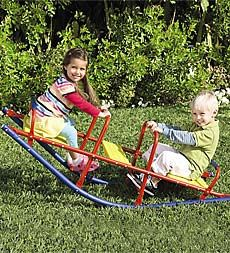 Durable Weather-Resistant Metal Rocking Seesaw. I played on this all the way up to jr. high! lol We would sit on this for hours and talk.