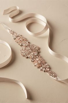 ivory and blush flowers bloom from a silk ribbon  d6d6014a25eb