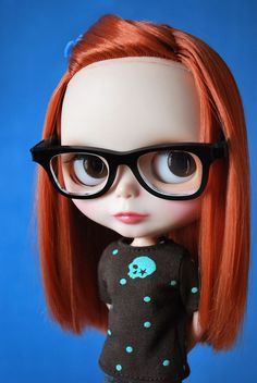 """blythe. This is Eliza in doll-form, down to the skull sweater color combo and her """"librarian"""" glasses."""