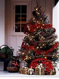 Straw bales with ribbon as presents under porch tree