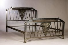 "A metal Art Deco bed having nickel over bronze inspired central panels circa 1930. Ht: 43"" Width: 55"""