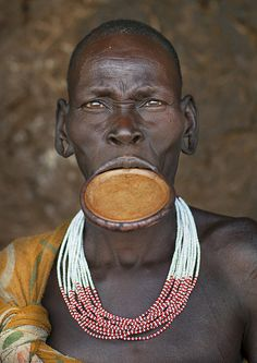 faces,Suri woman with lip plate,  Omo valley, Ethiopia by Eric Lafforgue, via Flickr