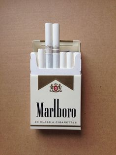 Marlboro Gold High Quality Regular Cigarettes Now Featuring These Great Deals 16 Cartons All Cigarette Quotes, Cigarette Brands, Cigarette Box, Gold Aesthetic, Bad Girl Aesthetic, Malboro, Marlboro Blue, Marlboro Lights, Free Coupons By Mail