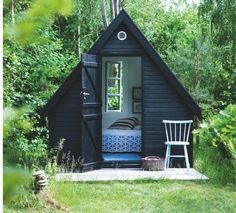 A tiny guest room A-frame painted black, via Tia Borgsmidt/Bolig Magazinet