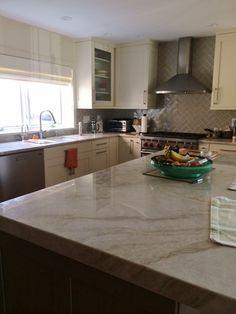 Warm kitchen with Perla Venata quartzite countertops and a herringbone tile backsplash.  Kitchen by Stoneshop from Cherry Hill, NJ.