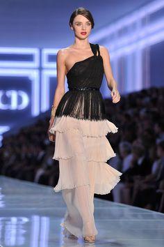 Miranda in busy yet lovely Christian Dior dress 2012