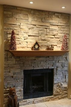 Cool Stone Fireplace Mantels for Interior Design: Floating Mantel For Stone Fireplace Mantels And Limestone Fireplace Plus Artificial Christmas Tree With Interior Paint Ideas And Recessed Lighting Also Stone Fireplace Hearth For Living Room Design Traditional Family Rooms, Natural Stone Fireplaces, Stone Fireplace Wall, Stone Veneer Fireplace, Fireplace Mantels, Fireplace