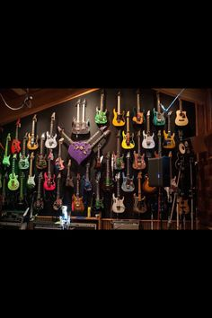 Steve Vai's guitars ~ The purple heart shaped one with three arms intrigues . . . did he have 3 hands, one for each guitar arm?