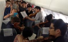 Orchestra members put on impromptu concert onboard delayed flight in China - Telegraph