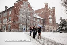 Northwest in the snow Northwest students navigate the campus through a snowstorm in November 2009. The winter of 2009-2010 brought a record snowfall to Maryville. (Photo by Darren Whitley/Northwest Missouri State)