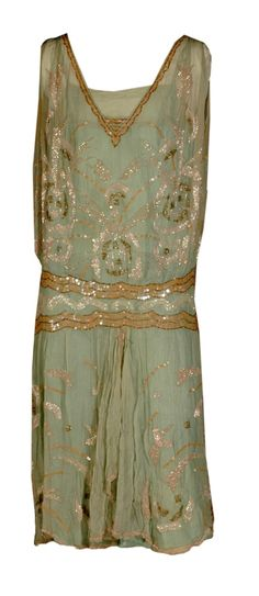 Sequined Green Rayon, 1920s    Edith Davis Bowen of Topeka was lucky enough to own this gown, another slip-on example from the 1920s.    Made of pale green rayon, this dress is decorated with white and coral beading, and copper-colored and pink sequins. The skirt is gathered at center front.