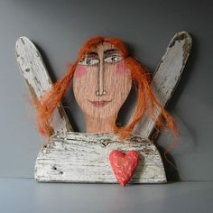 Jim Lambert, Folk Artist and owner of Against the Grain Studio makes the coolest, funkiest variety of mixed media sculptures.