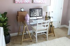 Love this cheap DIY idea for the desk- sawhorse spray painted and a piece of glass