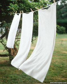 laundry blowing in the wind...nothing like the fresh smell of laundry hanging on a clothes line in your back yard. <3