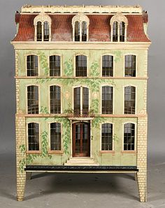 .Beautiful Dollhouse, four story, painted vines on front, great shape and design.  Rick Maccione-Dollhouse Builder www.dollhousemansions.com