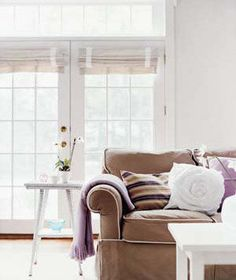 Highlight rich colors, such as chocolate brown and soft purples, by placing them against a backdrop ofwhite.