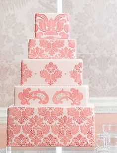 Lovely Pink Damask Wedding Cake. I love the different but cohesive alternating layers.