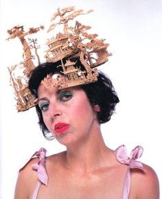 Isabella Blow in Philip Treacy's 'Chinese Garden Headdress' hat carved from cork. 'It's Only A Game' collection Spring/Summer 2005